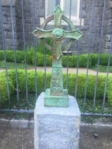 A bronze memorial cross in the courtyard of Trinity Cathedral. It is the work of acclaimed artist (and Trinity parishioner) Mary Chomenko Hinkley given in memory of her brother Tony.