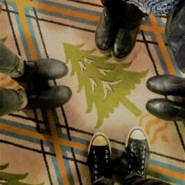 Taking a moment to pray as we stand on the Oregon-forest-themed carpet.
