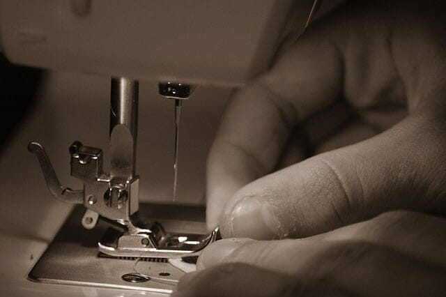 A hand sewing with a sewing machine