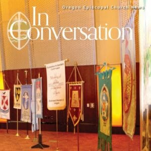 "a row of church banners in a room with reddish-orange carpet and the words ""In Conversation: Oregon Episcopal Church News"""